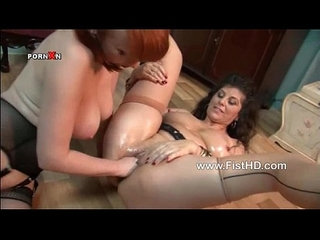 Two hot lesbian MILFs are fisting hard