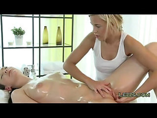 Oiled lesbians licking and fingering each other