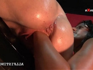 Oily tattooed lesbo gets cunt fisted from back